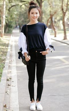 灯笼袖拼色时尚圆领上衣,面料舒适柔软,搭配脚口i开叉牛仔裤,休闲不失时尚。