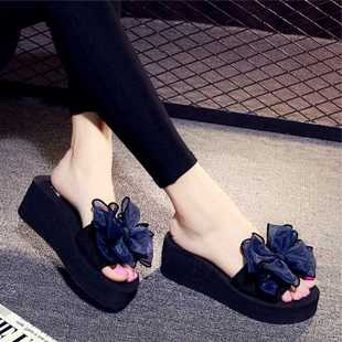 Black slippers are worn by women. They wear summer waves