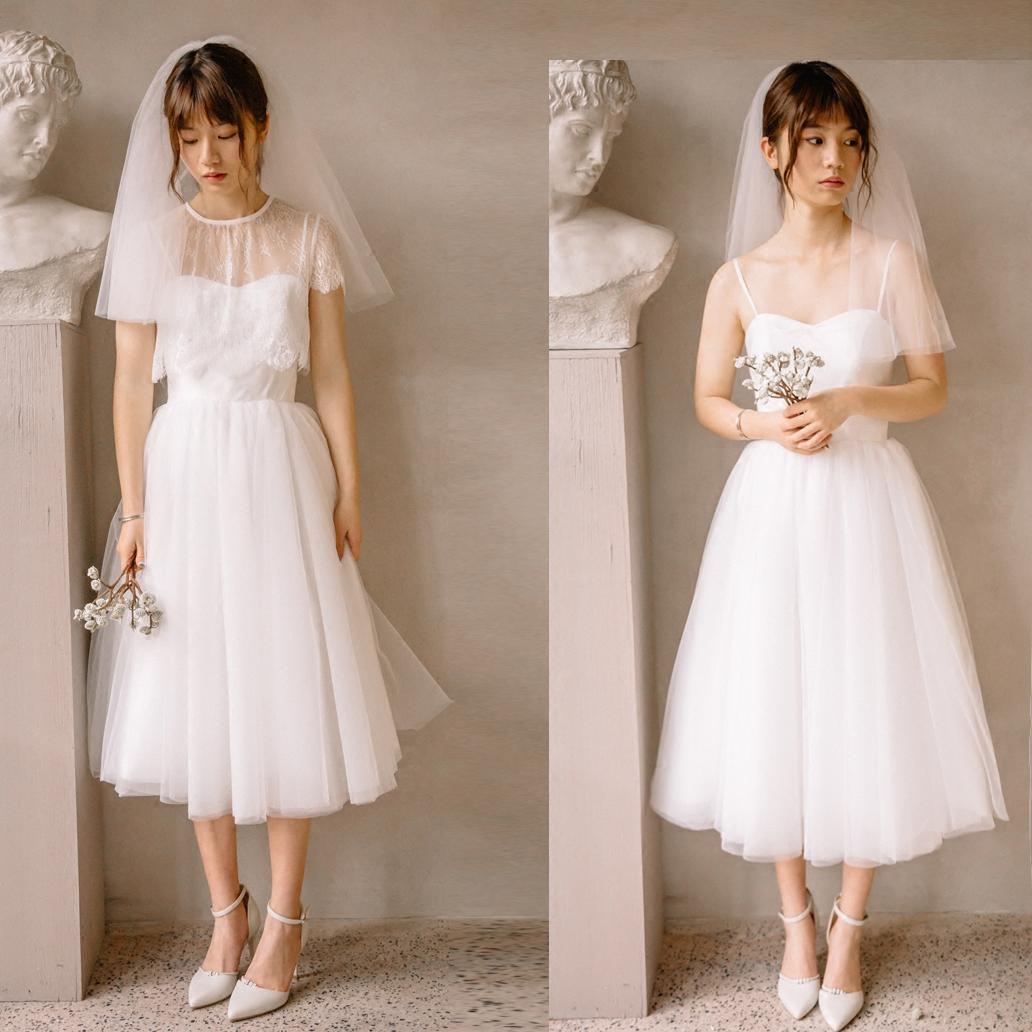 2018新款两穿轻婚纱礼服旅行旅拍写真短款蕾丝吊带A摆公主森系纱婚纱