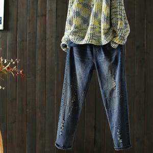 西缺原创 时尚绣线 复古破洞棉质牛仔裤女春季新款哈伦小脚长裤子