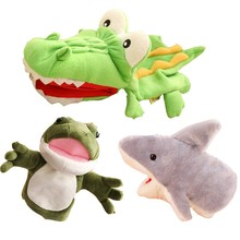 Animal dolls simulate plush toys. Children comfort dolls. Big-mouthed frog crocodile dolls before bedtime