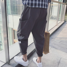 Summer wide-legged nine-minute trousers men's Korean version of the trend of relaxation Hallen trousers Les les Shuai t Port wind BF calf sports pants