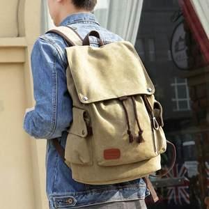 男士<span class=H>双肩包</span>个性学生旅行包新款潮流韩版书包帆布帅气时尚背包休闲