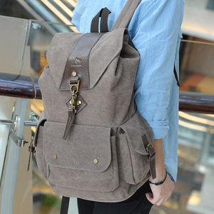 帆布双肩包男士英伦复古抽带搭扣简约休闲学生<span class=H>书包</span>大容量旅行背包
